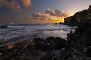 A small beach along the Mahaulepu Heritage Trail near Shipwreck Beach on Kauai island in Hawaii.