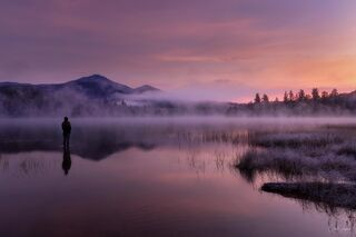 Dramatic sunrise at Connery Pond in the Adirondacks of New York.