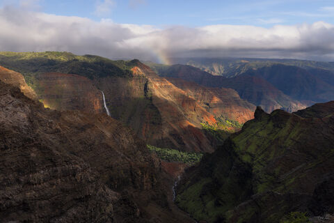A rainbow formed above Waimea Canyon on Kauai Island in Hawaii.