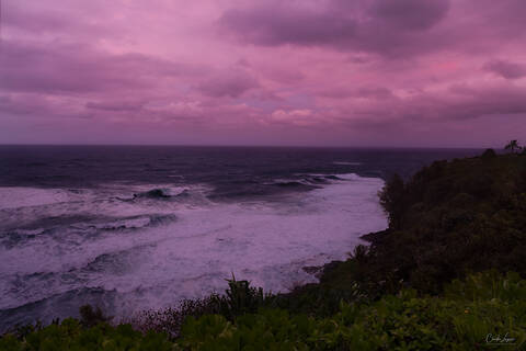 Dramatic sunset and waves at The Cliffs Resort in Princeville on Kauai Island in Hawaii.