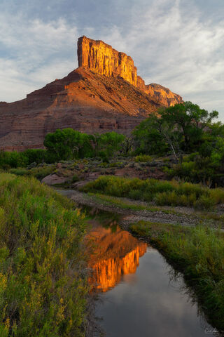 Reflection of Red Rock Formation in Gateway in Colorado at sunrise.