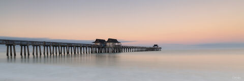 View of Naples Pier in Naples in Florida at sunrise.