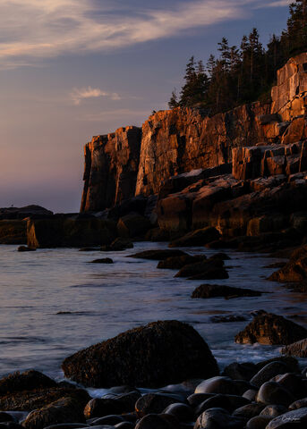 View of Otter Cliff at Boulder Beach in Acadia National Park at sunrise.