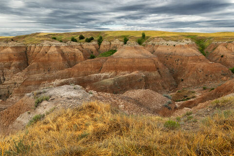 View of colorful buttes at Badlands National Park in South Dakota at sunrise.