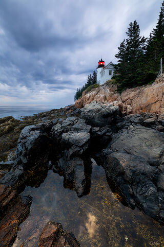 View of Bass Harbor Head Lighthouse at sunset in Acadia National Park in Maine.