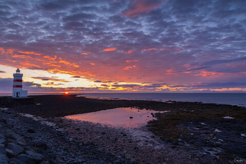 View of Gardur Lighthouse in Iceland at sunset.
