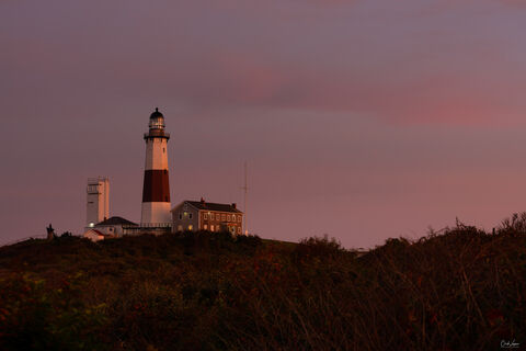 View of Montauk Point Lighthouse in New York at sunset.
