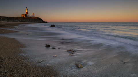 View of Montauk Point Lighthouse in Mountauk in New York at sunset.