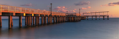 View of Steeplechase Pier at Brighton Beach in New York City at sunset.