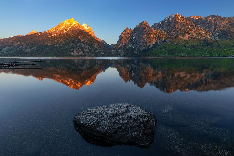 A reflection of Grand Teton Mountain Range in Jenny Lake at Grand Teton National Park.