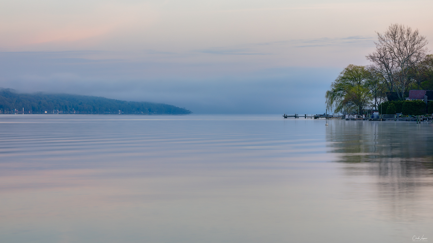 View of Cayuga Lake at sunrise in Ithaca in New York.