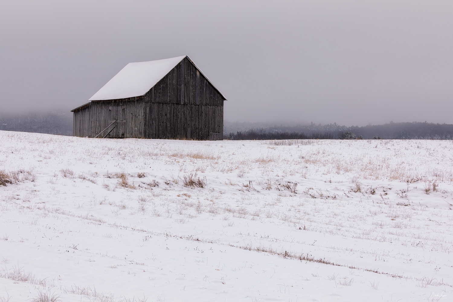 Barn covered in snow in Ripon in Queben, Canada.