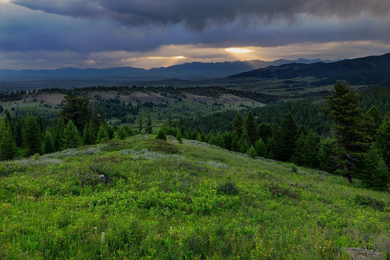 Sun breaking through clouds above the Bridger Mountains in Montana.