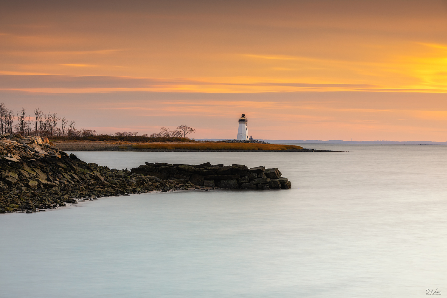 View of Fayerweather Lighthouse in Bridgeport Connecticut at sunset.