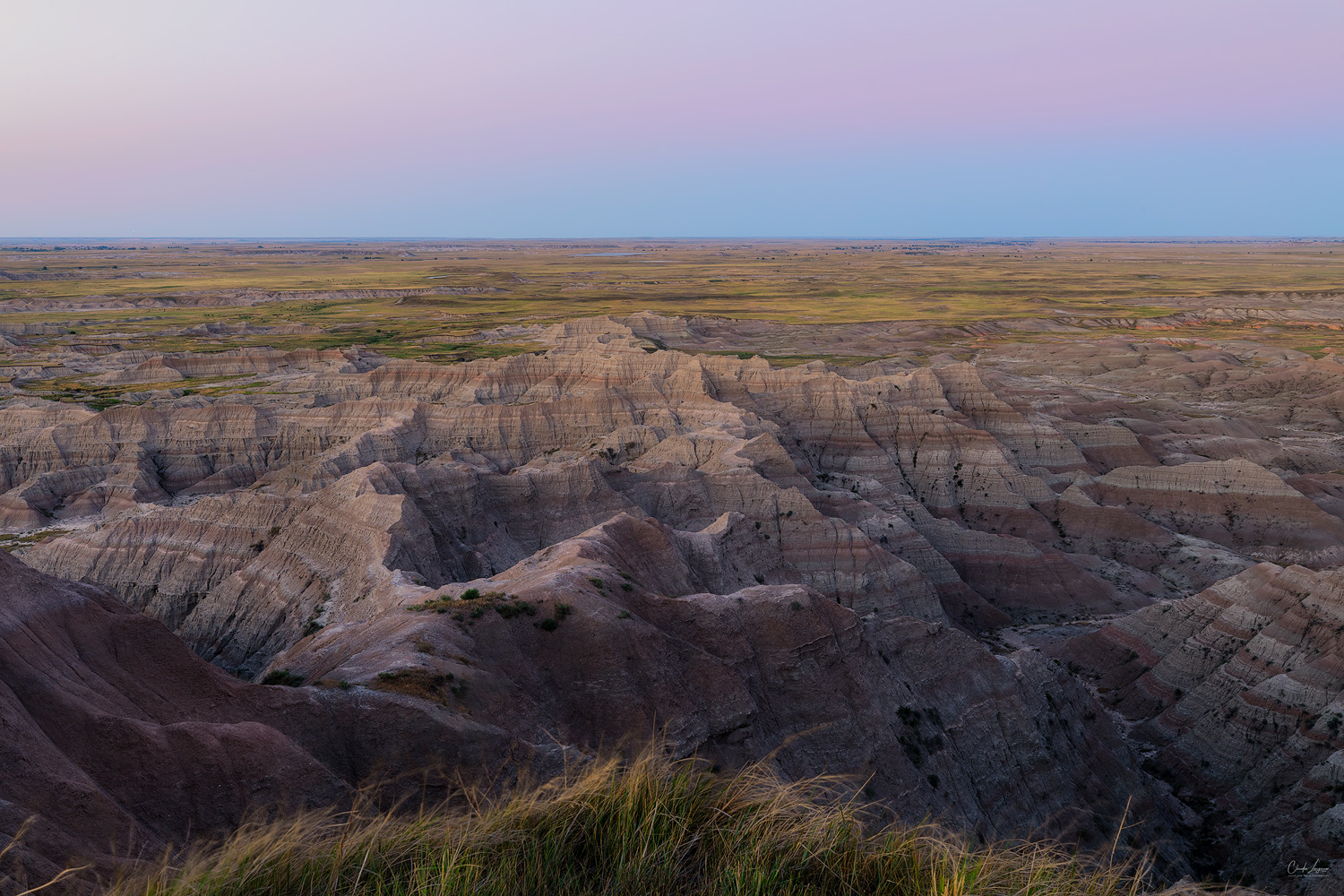 View of colorful buttes at Badlands National Park in South Dakota at sunset.