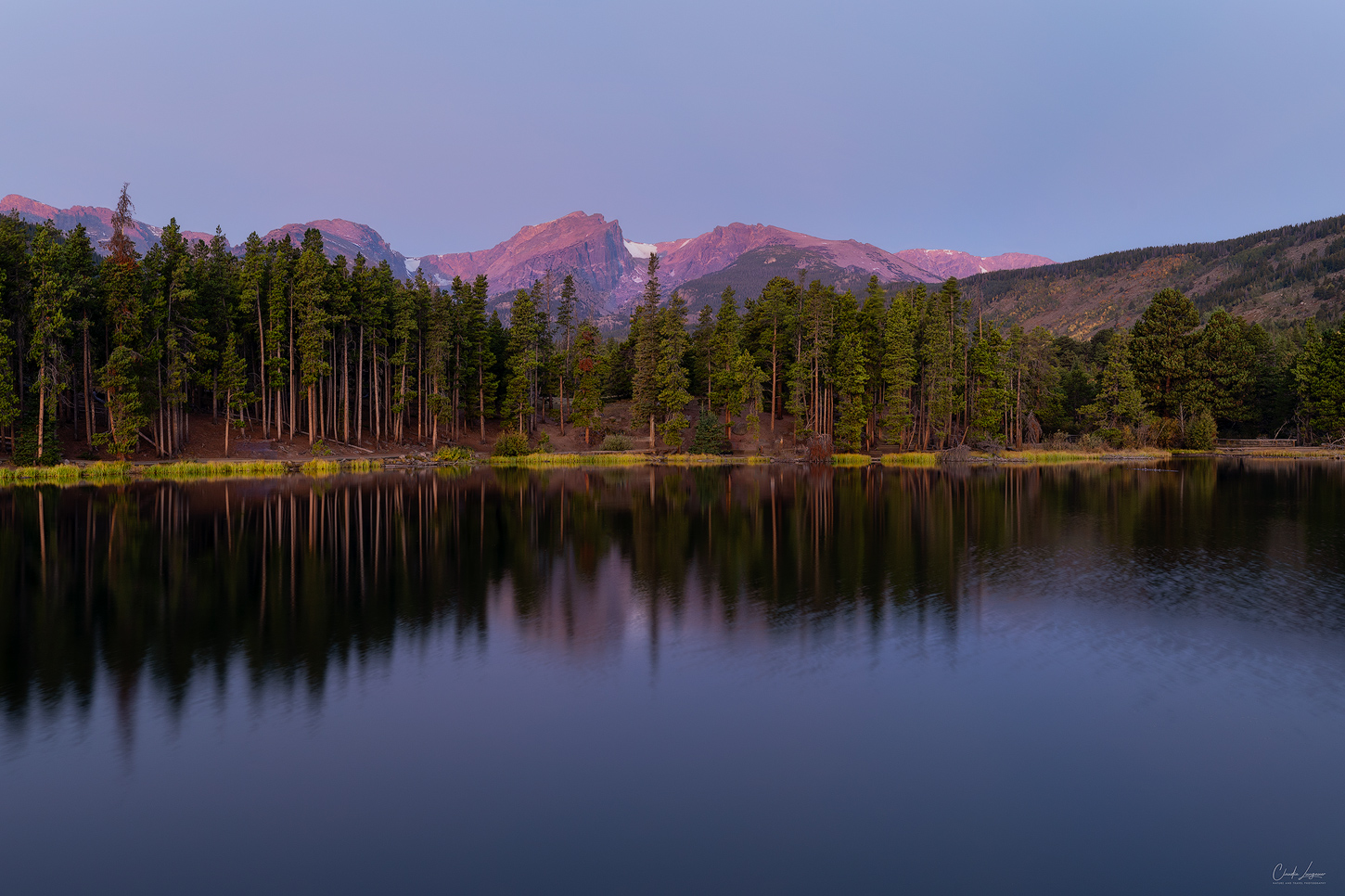 Reflection of the Continental Divide at Sprague Lake in Rocky Mountain National Park.