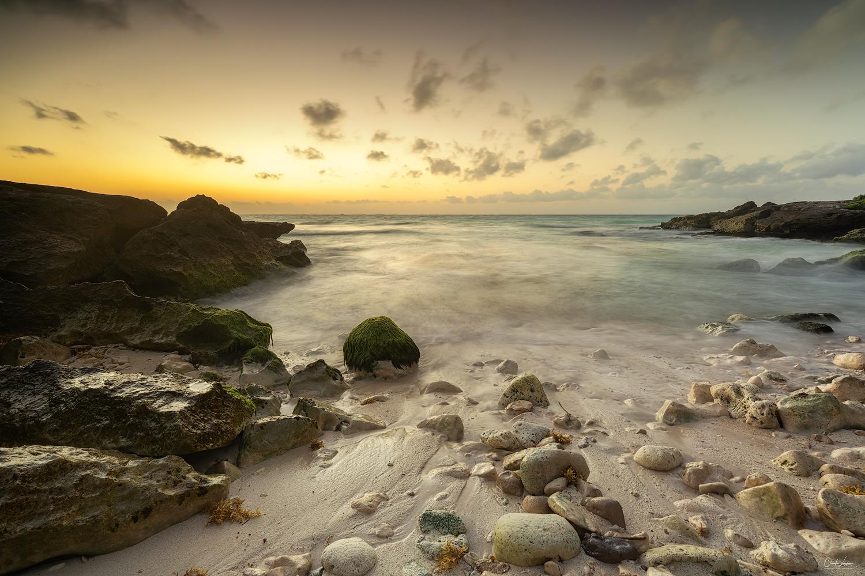 Sunrise at a small beach in Tulum in Mexico.