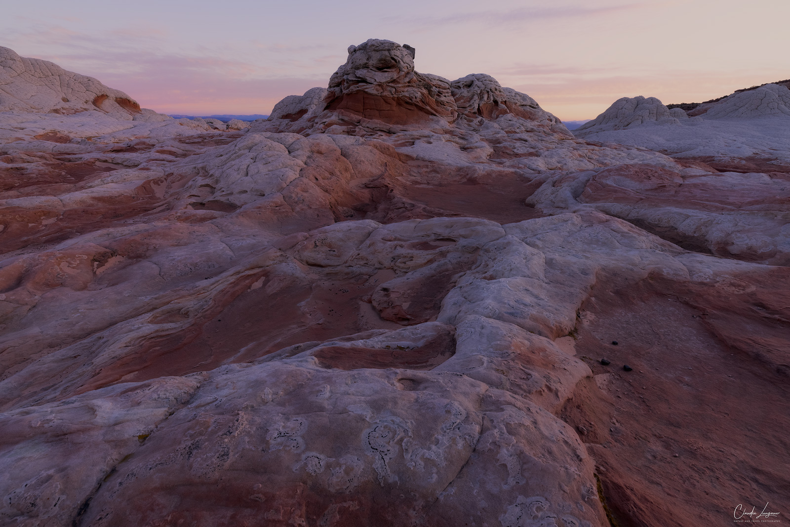 View of rock formations in White Pocket in Arizona at sunrise.
