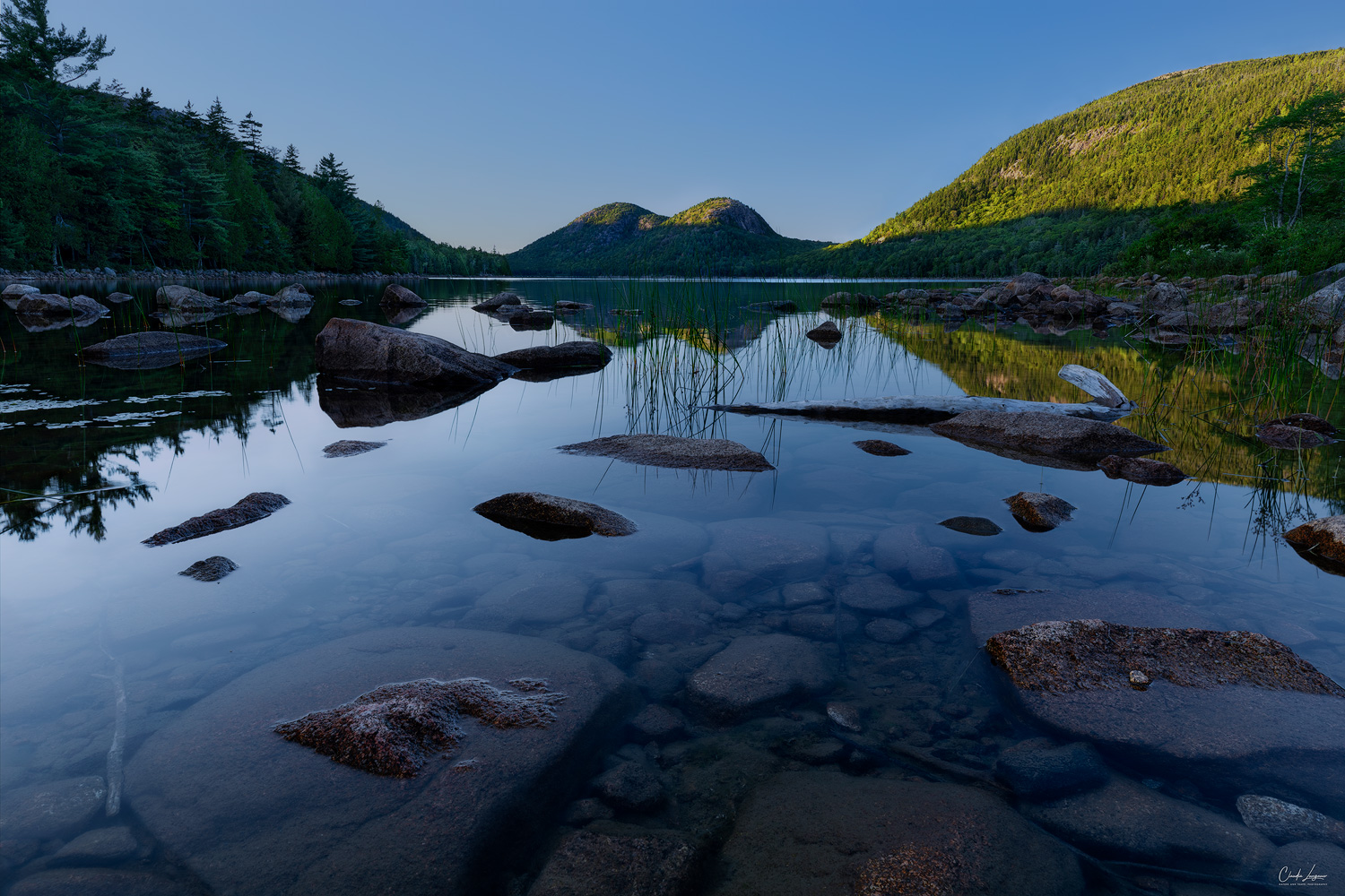 View of the Bubbles at Jordan Pond in Acadia National Park at sunset.