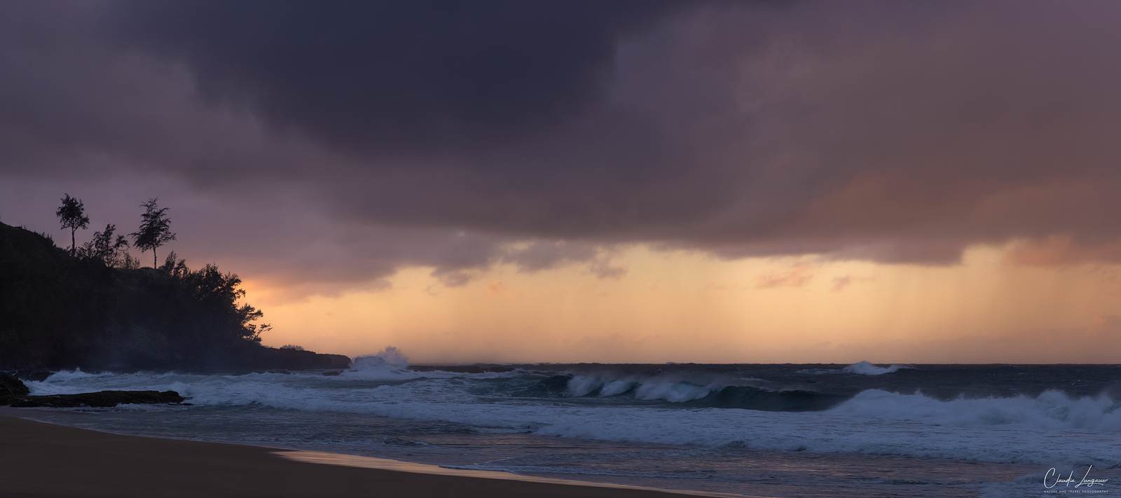 Dramatic clouds and waves at Secret Beach on Kauai's north shore in Hawaii.