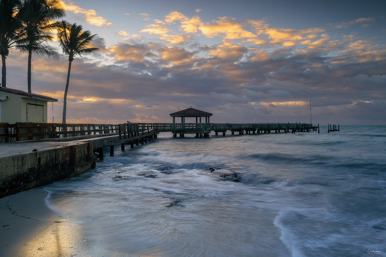 View of the pier at John & Mary Spottswood Waterfront Park in Key West in Florida at sunrise.